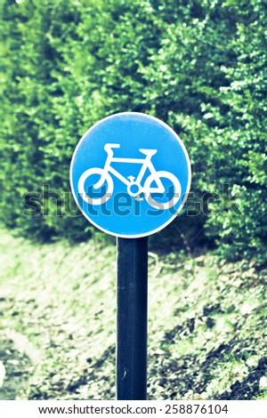 Sign for a cycle route on a rural road with retro filter applied
