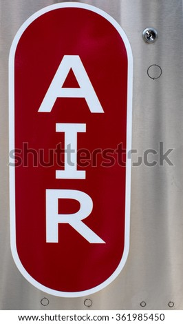 Sign for compressed air pump at gas station - stock photo