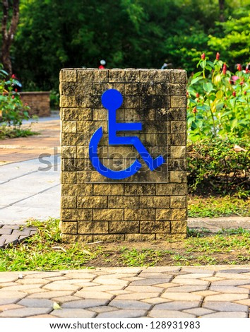 Sign for  elderly made from brick  in garden