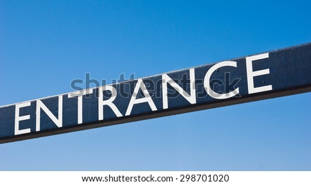 Sign for entrance on a metal rod.  - stock photo