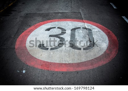 Sign for the speed limit on road - stock photo