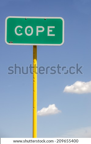 Sign for the town of Cope, Colorado.  Use it for anything that applies to the words cope, coping, cope with, deal with, get by, face, handle, etc. - stock photo