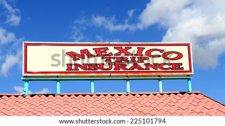Sign found in southern Arizona selling trip insurance for going into Mexico - stock photo
