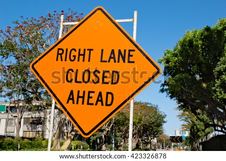 Sign gives warning that the right lane is closed ahead due to road construction.