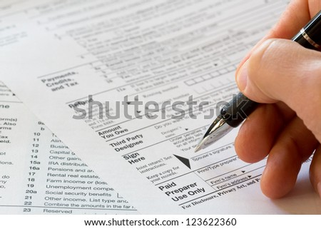sign here, 1040 tax form - stock photo