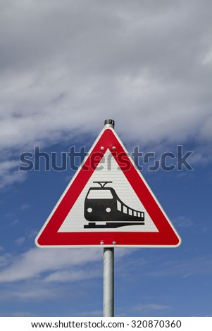 Sign in front of a railroad crossing - stock photo