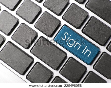 sign in or login concept with key on computer keyboard  - stock photo