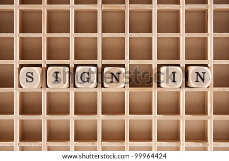 Sign-in word construction with letter blocks / cubes and a shallow depth of field - stock photo