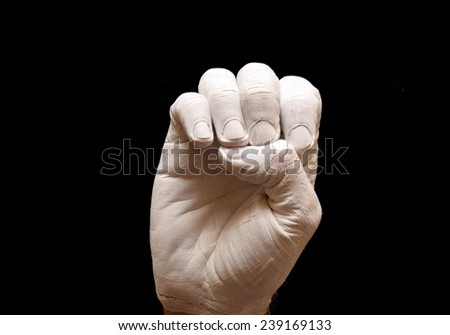 Sign Language American alphabet with hands painted white over black background letter e