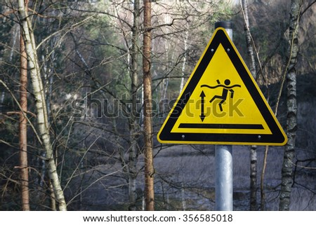 sign not allowed to swim in water. Dangerous place where man can drown - stock photo