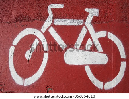 sign of a bicycle on the road - stock photo
