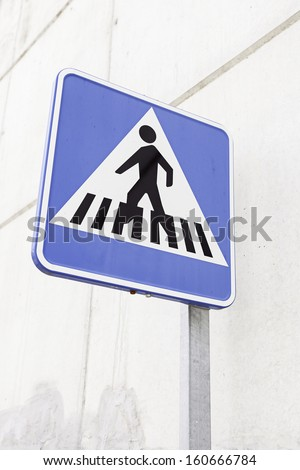 Sign of a zebra crossing, detail of an information signal on the street, caution and information - stock photo