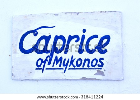 Sign of Caprice of Mykonos - stock photo