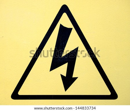 Sign of danger high voltage symbol - stock photo