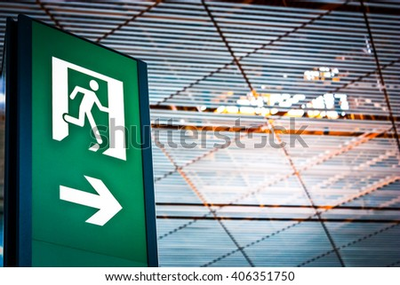 Sign of emergency exit in a Chinese airport, good for conceptual