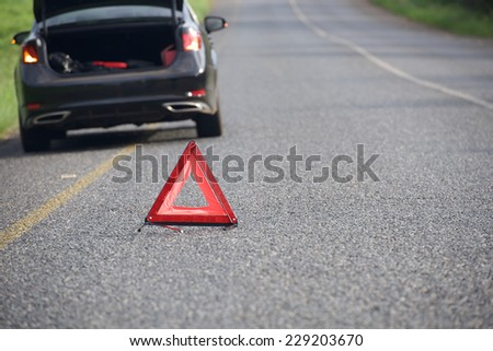 Sign of emergency stop car on the road - stock photo