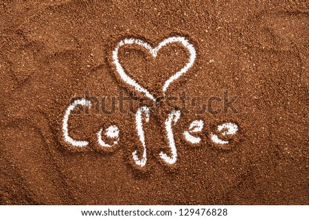sign of heart made in ground coffee - stock photo