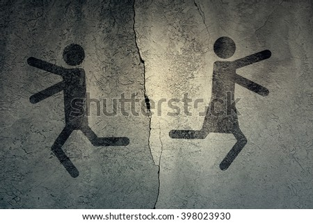 Sign of men and women running in different directions on the background of a concrete wall divided by cracks. Toned - stock photo