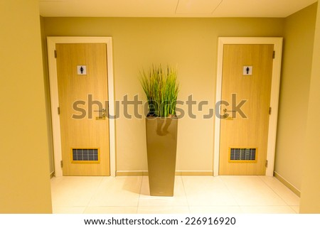 Sign of public toilets WC on wooden door - stock photo
