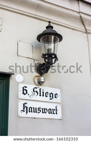 sign on a house in vienna. here the janitor or caretaker is catch me. - stock photo
