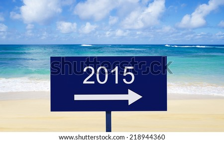 "Sign ""2015"" on a nameplate by the ocean"