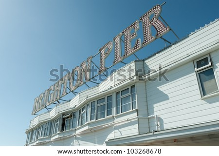 sign on Brighton Pier, one of the top seaside tourist attractions in the UK - stock photo