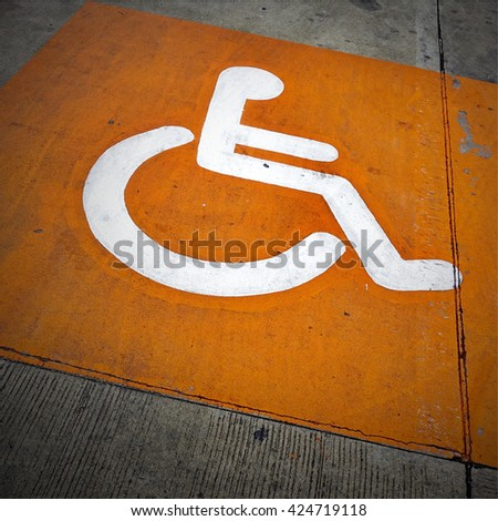 Sign on car park reserved for handicap person - stock photo
