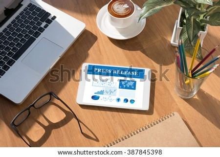 sign on tablet on screen, table and coffee Tablet on a desk - Press Release Concept,coffee - stock photo