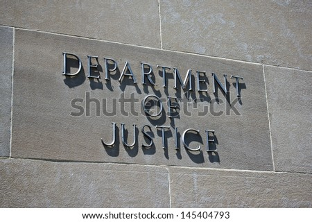 Sign on the exterior identifies the Department of Justice.