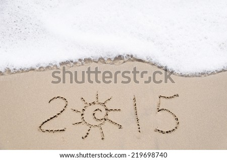 "Sign ""2015"" on the sandy beach by ocean"