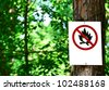 Sign on tree in forest - Prohibited fire concept - stock photo