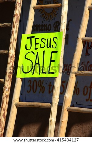 sign outside a retail store saying: Jesus sale/Jesus/ sign outside a store in Argentina  saying:Jesus sale