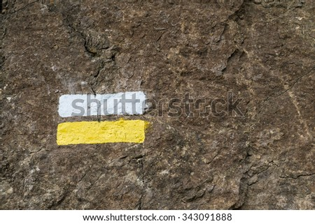 Sign  painted on a rock to mark the way for hikers - stock photo