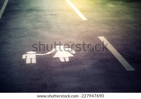 Sign painted on the road - stock photo