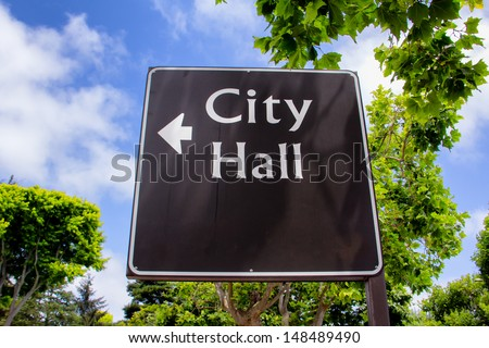 Sign Pointing in direction of City Hall - stock photo