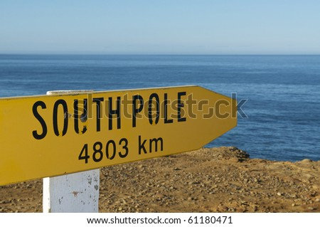 Sign Pointing to the South Pole from New Zealand's most Southern Point - stock photo