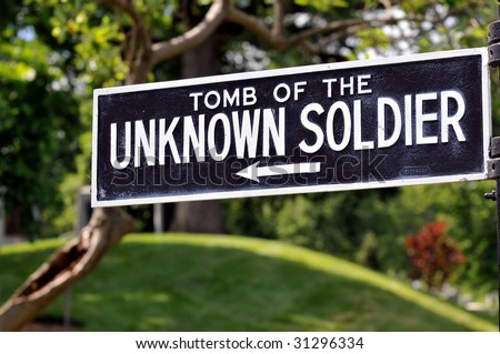 Sign pointing to the Tomb of the Unknown Soldier at the Arlington National Cemetery in Arlington, Virginia, near Washington DC - stock photo