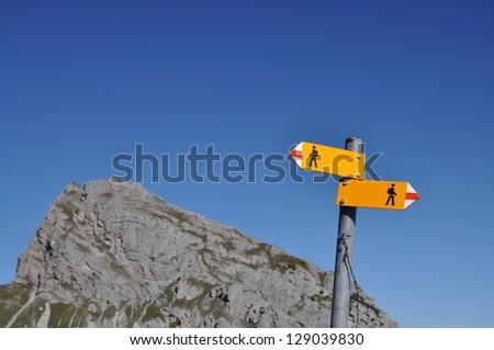 Sign post in Switzerland - stock photo