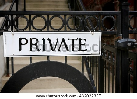 Sign PRIVATE� on metallic gate with lock