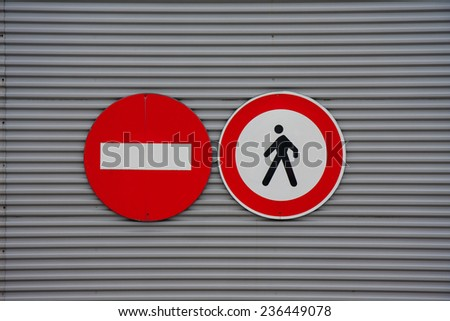 sign prohibiting pedestrian access on metal wall - stock photo