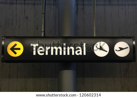 Sign showing the way to the airport terminal building - stock photo