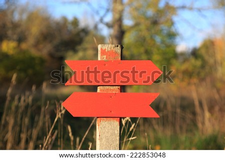 Sign showing walk path to the right and left. - stock photo