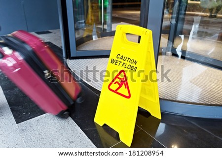 Sign showing warning of caution wet floor  - stock photo