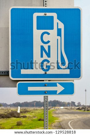 Sign shows direction of the nearest CNG station. - stock photo