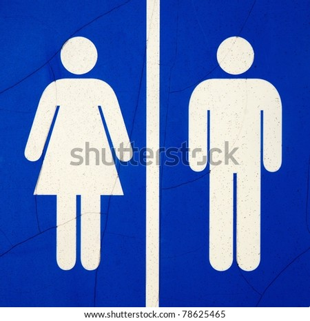 sign shows the way to the restroom - stock photo