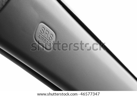 Sign SRS Aairbag, located at the front desk car, shot in close-up - stock photo