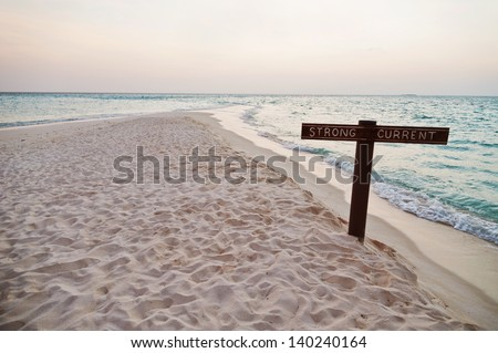 Sign stong current on the sea at the sunset - stock photo