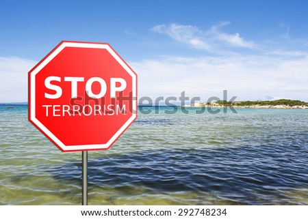 Sign Stop Terrorism on the beach - stock photo