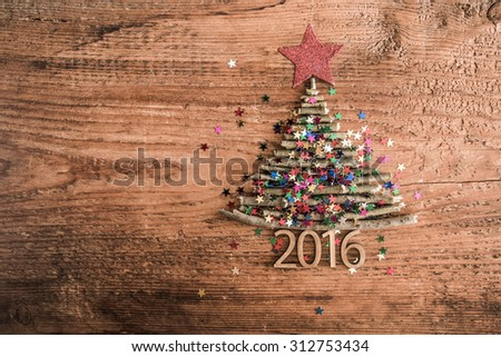 Sign symbol from many dry Stick Christmas green Tree a lot colorful star toys on old retro vintage style wooden texture background Empty copy space for inscription Idea of merry new year 2016 holiday - stock photo
