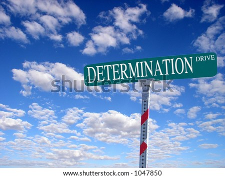 "sign that reads ""Determination Drive"""